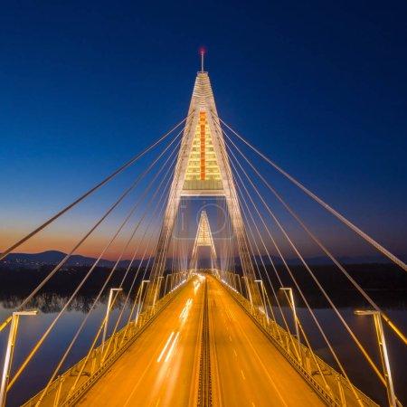 Photo for Budapest, Hungary - Aerial view of the illuminated Megyeri Bridge at blue hour - Royalty Free Image