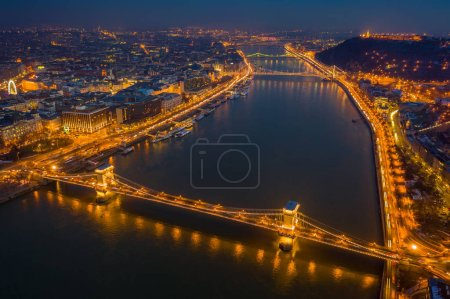Photo for Budapest, Hungary - Aerial view at blue hour of Szechenyi Chain Bridge, Elisabeth Bridge and Statue of Liberty at winter time - Royalty Free Image