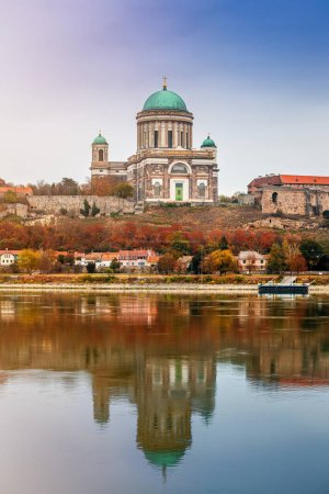 Photo for Esztergom, Hungary - Beautiful autumn morning with the Basilica of the Blessed Virgin Mary at Esztergom by the River Danube. Autumn colors and reflections of the Basilica are mirrored in water - Royalty Free Image