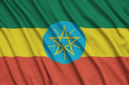 Ethiopia flag  is depicted on a sports cloth fabric with many folds. Sport team waving banner