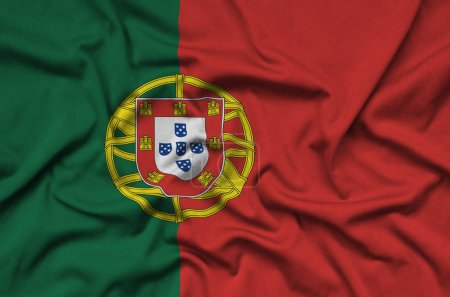Portugal flag  is depicted on a sports cloth fabric with many folds. Sport team waving banner