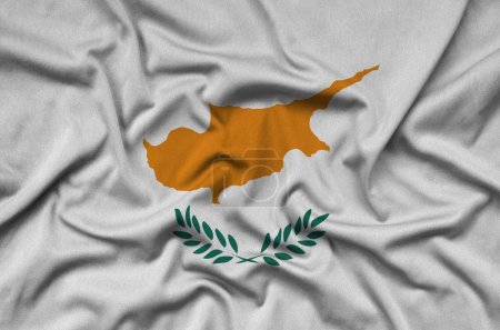 Cyprus flag  is depicted on a sports cloth fabric with many folds. Sport team waving banner