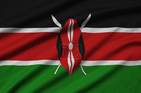 Kenya flag  is depicted on a sports cloth fabric with many folds. Sport team waving banner