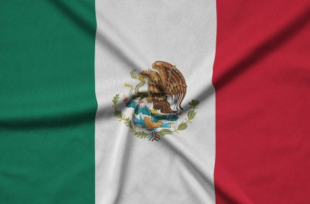 Mexico flag  is depicted on a sports cloth fabric with many folds. Sport team waving banner