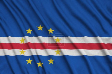 Cabo verde flag  is depicted on a sports cloth fabric with many folds. Sport team waving banner