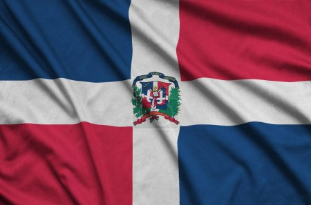 Dominican Republic flag  is depicted on a sports cloth fabric with many folds. Sport team waving banner