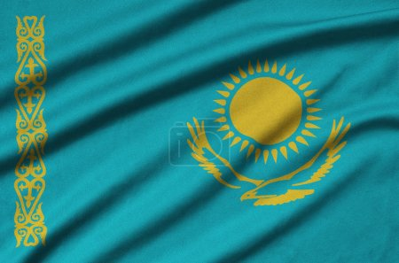 Kazakhstan flag  is depicted on a sports cloth fabric with many folds. Sport team waving banner