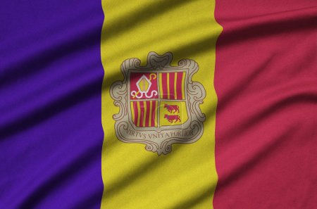 Andorra flag  is depicted on a sports cloth fabric with many folds. Sport team waving banner