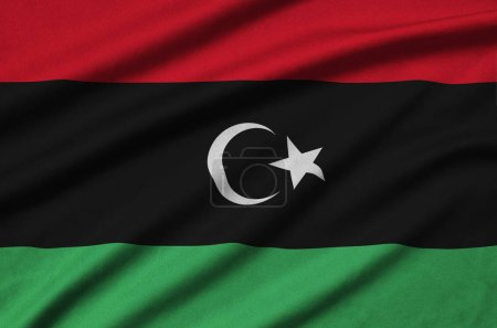 Libya flag  is depicted on a sports cloth fabric with many folds. Sport team waving banner