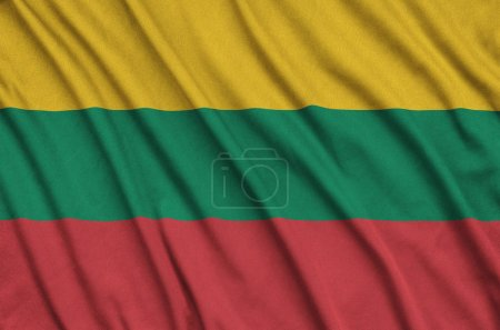 Lithuania flag  is depicted on a sports cloth fabric with many folds. Sport team waving banner