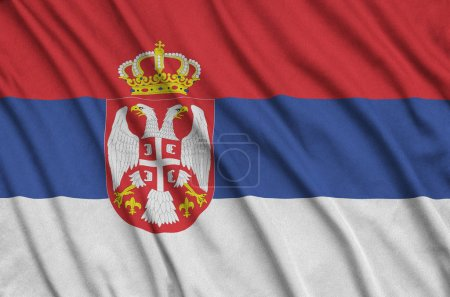 Serbia flag  is depicted on a sports cloth fabric with many folds. Sport team waving banner