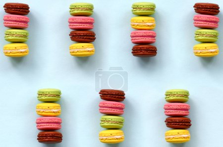 Photo for Dessert cake macaron or macaroon on trendy pastel blue background top view. Flat lay composition. - Royalty Free Image