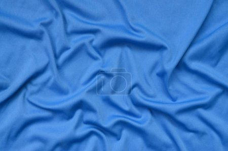 Foto de Detalle textura de poliéster azul con muchos pliegues largos - Imagen libre de derechos