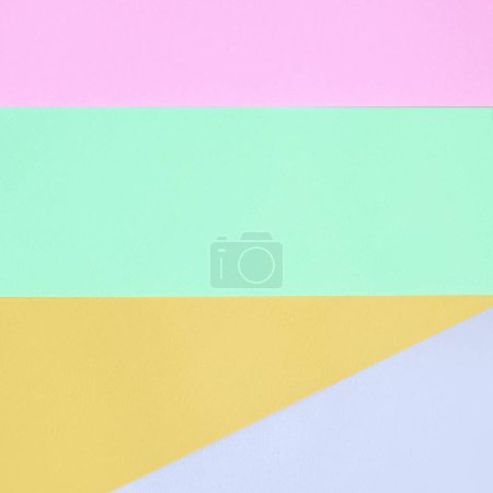 Texture background of fashion pastel colors. Pink, violet, orange and blue geometric pattern papers.