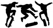 Silhouettes of teenagers jumping on a skateboard