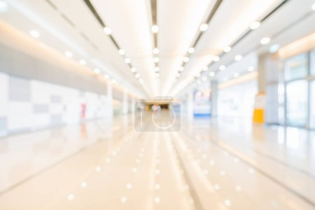 Photo for Blurred, defocused bokeh background of exhibition hall or convention center hallway. Business trade show event, modern white interior architecture, or commercial tradeshow conference seminar concept - Royalty Free Image