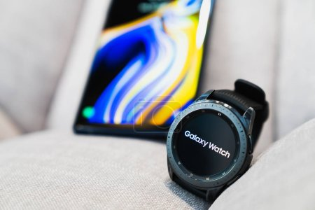Photo for Bangkok, Thailand - Sep 28, 2018: New smartwatch Samsung Galaxy Watch 42mm midnight black with onyx black strap, paired use with Samsung Galaxy Note 9. Illustrative editorial content - Royalty Free Image