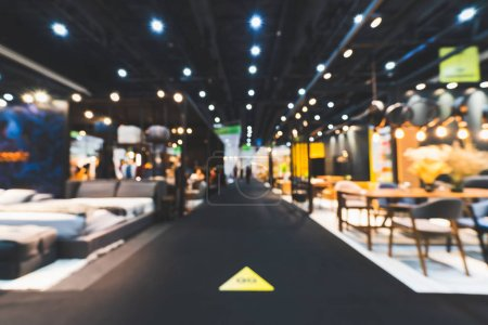 Photo for Blur, defocused background of public exhibition hall holding furniture fair event or business tradeshow. Commercial trading convention center, interior design expo, or shopping mall marketing concept - Royalty Free Image