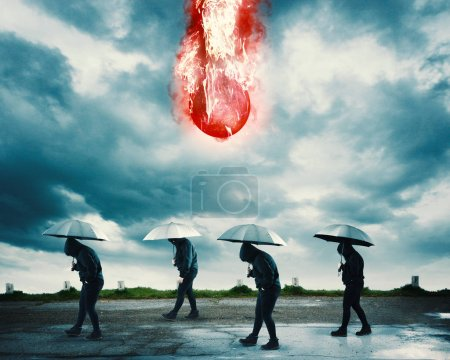 Photo for Group of people with umbrellas walking while a meteor is falling. - Royalty Free Image