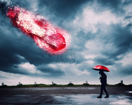 Photo for Man with an umbrella walking while a meteor is falling. - Royalty Free Image