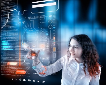 Photo for Woman working on digital touch screen with data and informations.Futuristic user interface. - Royalty Free Image