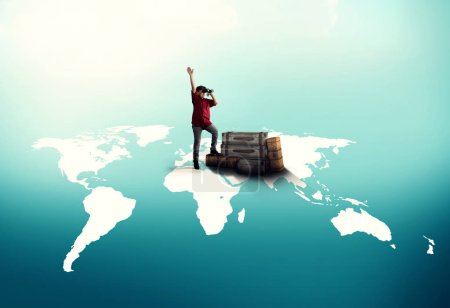 Photo for Traveler with luggages standing on world map and looking through binoculars. The concept of hitch-hiking. - Royalty Free Image