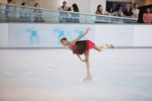 the  young skater performs on the ice
