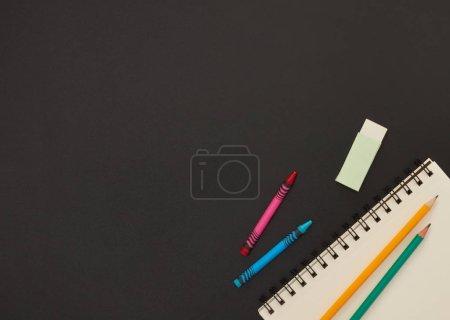 School supplies on chalkboard