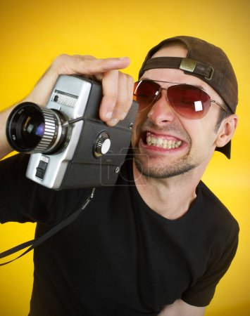 Photo for Cameraman with 8mm camera - Royalty Free Image