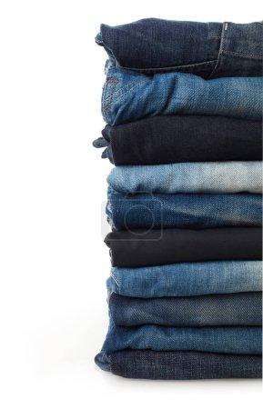 Photo pour Pile de jeans isolé sur blanc - image libre de droit