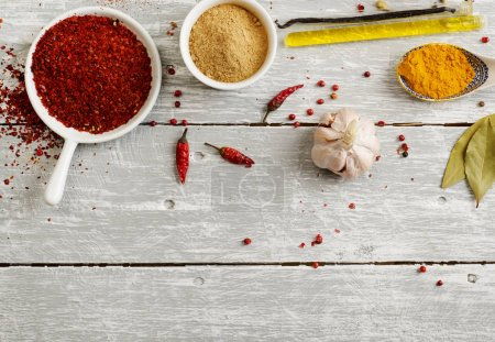 Photo for Different spices on wooden table - Royalty Free Image