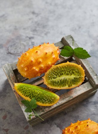 Photo for Kiwano fruit on a crate - Royalty Free Image