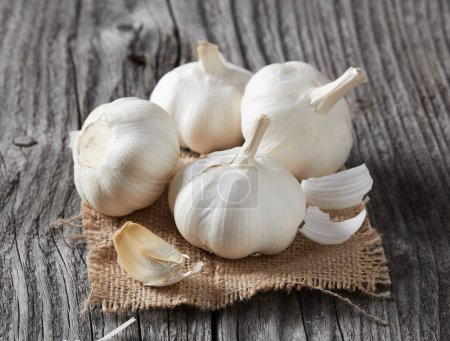 Photo for Garlic and clove on wood - Royalty Free Image