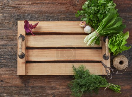Photo for Herb leafs on wood table - Royalty Free Image