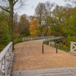 Muskau Park and wooden bridge over Neisse river at...
