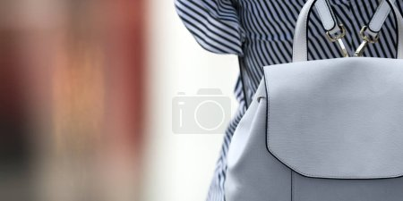 Photo for Partial view of back view woman wearing backpack - Royalty Free Image