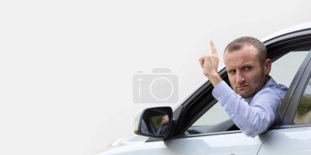 Photo for Aggressive and furious driver gesturing with finger from car - Royalty Free Image