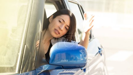Angry and tense woman stuck in the traffic