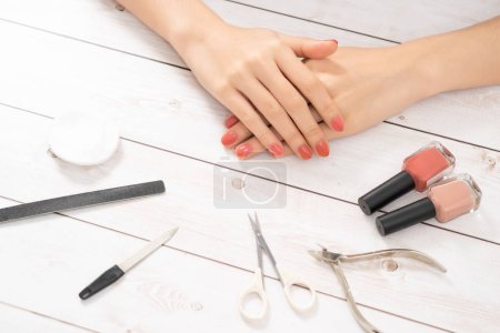 Nail care and manicure. Beautiful female hands with pink nail polish