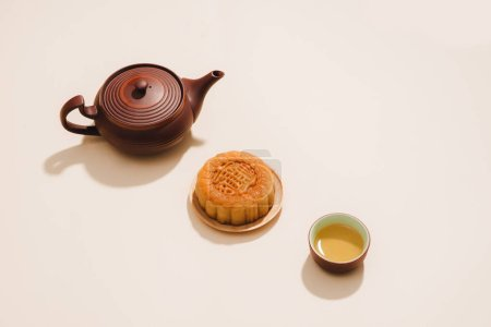 Mid-Autumn Festival round mooncakes and tea on light background with copy space