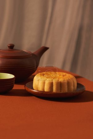 Mid-Autumn festival, an asian celebration, served with traditional mooncakes. Text mean Happiness.