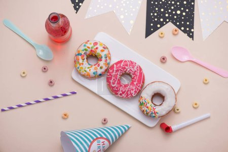 Photo for Bright birthday background with doughnuts and decorations - Royalty Free Image