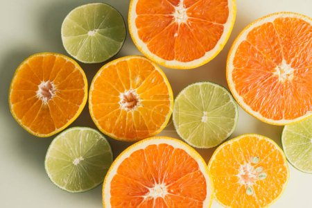 Photo for Composition with slices of citrus fruits on white background - Royalty Free Image