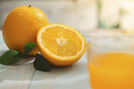 Photo for Close-up of fresh ripe oranges and glass of fresh orange juice - Royalty Free Image