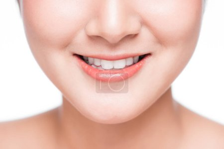 Photo for Close-up of smiling young asian woman face - Royalty Free Image