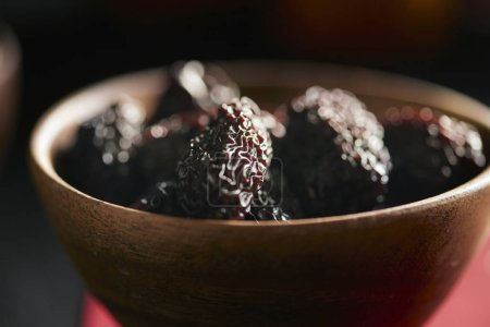 Photo for Close-up of dried fruits in bowl on dark background - Royalty Free Image