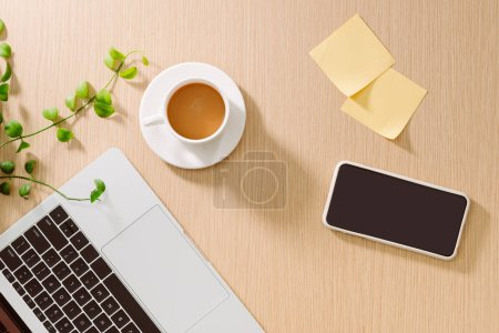 Trendy feminine home office workspace. White office desk. Laptop, coffee cup and phone, notebook, pencil. Flat lay, top view, copy space