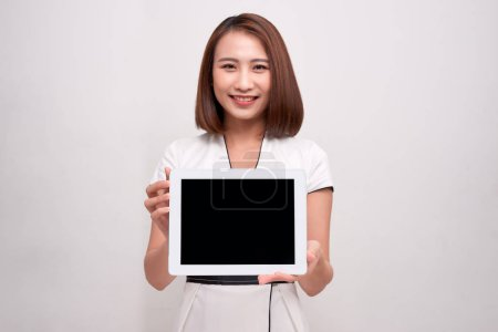 Photo for Asian business woman holding ipad tablet - Royalty Free Image