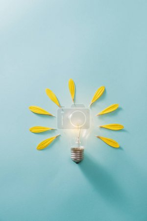 Photo for Ecology and energy saving concept with eco bulb - Royalty Free Image