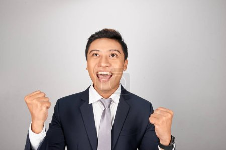Photo for Young handsome businessman cheering carefree and excited. Victory concept. - Royalty Free Image